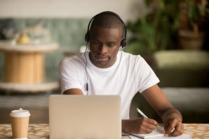 Young Black Man Taking a course online.